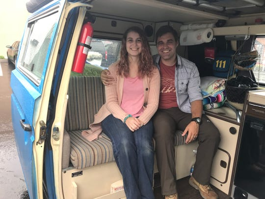 Before hitting the road, Megan and Justin Webb pose inside their Volkswagen van in a Knoxville parking lot on Sept. 27, 2018.