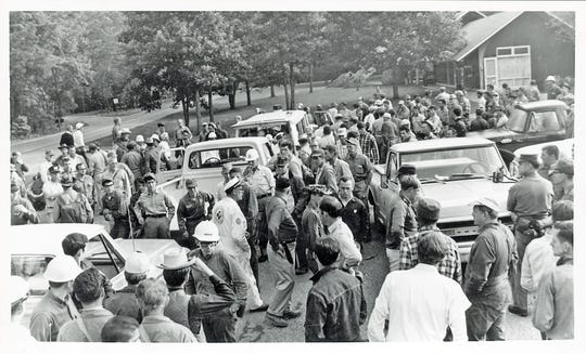 "Searchers for Dennis Martin, 6, crowd the Cades Cove campground headquarters on June 21, 1969, in the Great Smoky Mountains National Park. Some 1,300 ""good neighbors"" were trying to find the little boy lost in the Smoky Mountains."