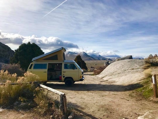 Pictured is the van Justin and Megan Webb purchased in Boise, Idaho, and transformed into an evacuation shuttle from the video game Fallout to travel the country together.