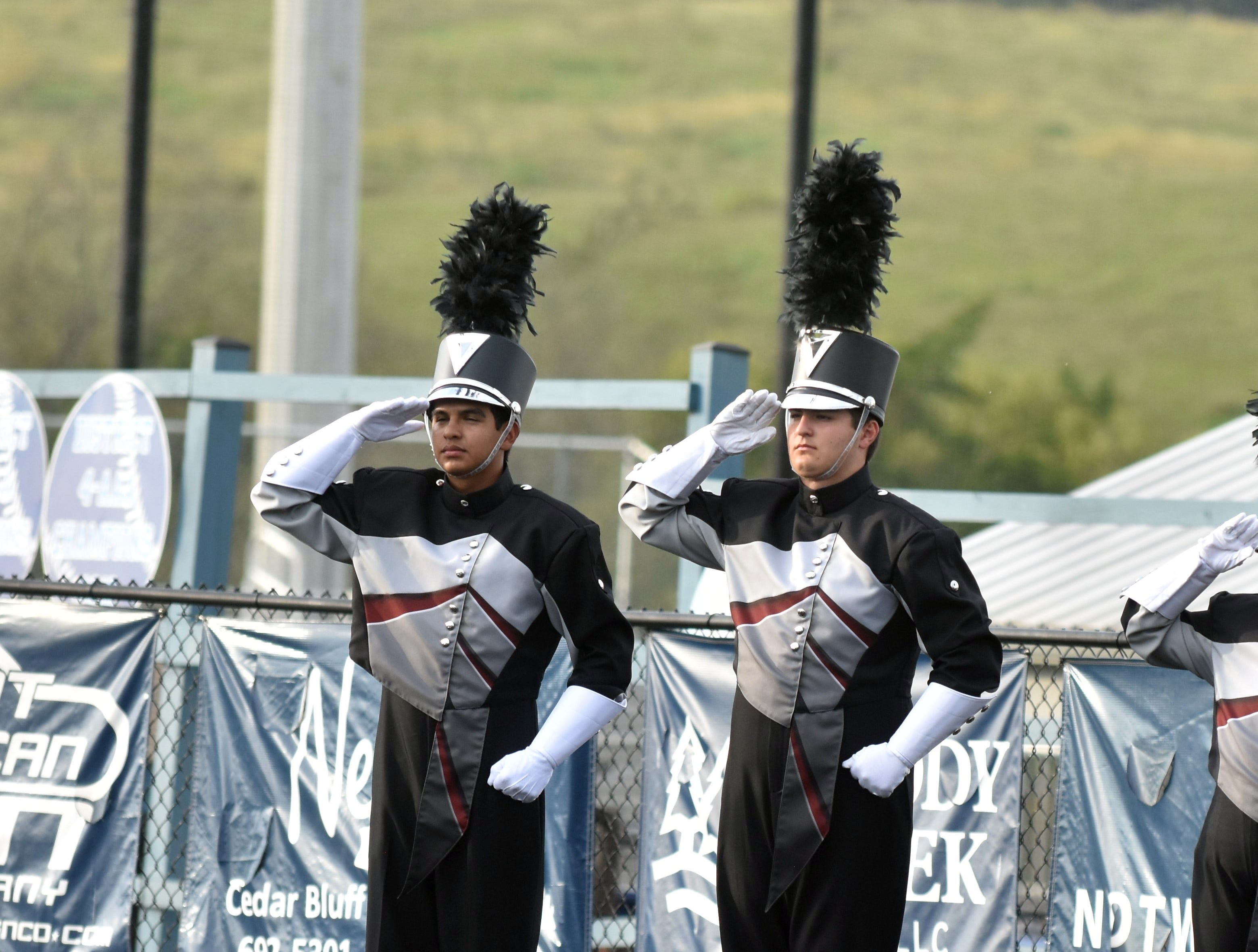 Bearden High band members salute the flag prior to the opening of the Knox County band exhibition on Monday, October 1.