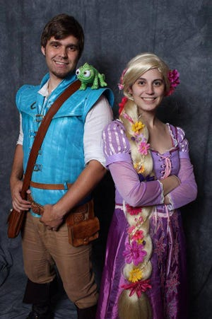 "Justin and Megan Webb dress as Flynn Rider and Rapunzel from the movie ""Tangled."" The Knoxville couple have sold their belongings to travel the country together attending cosplay conventions."