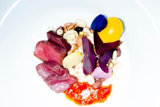 Rebel Kitchen's Nicoise salad features olive oil-poached tuna, olives, heirloom cannellini beans, potato, egg yolk and tomato vinaigrette.