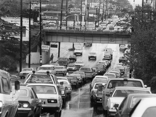 Cars drive down Cumberland Avenue, in Knoxville, Thursday, April 23, 1981