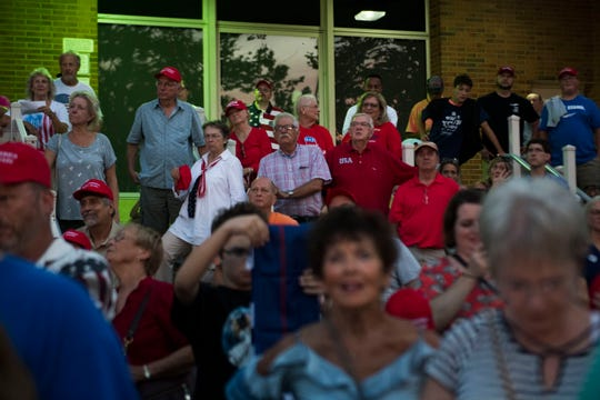 Trump supporters who were unable to go inside the hall, watch the rally outside, during a Donald Trump rally in support of U.S. Rep. Marsha Blackburn for the U.S. Senate at Freedom Hall Civic Center in Johnson City, Monday, Oct. 1, 2018.