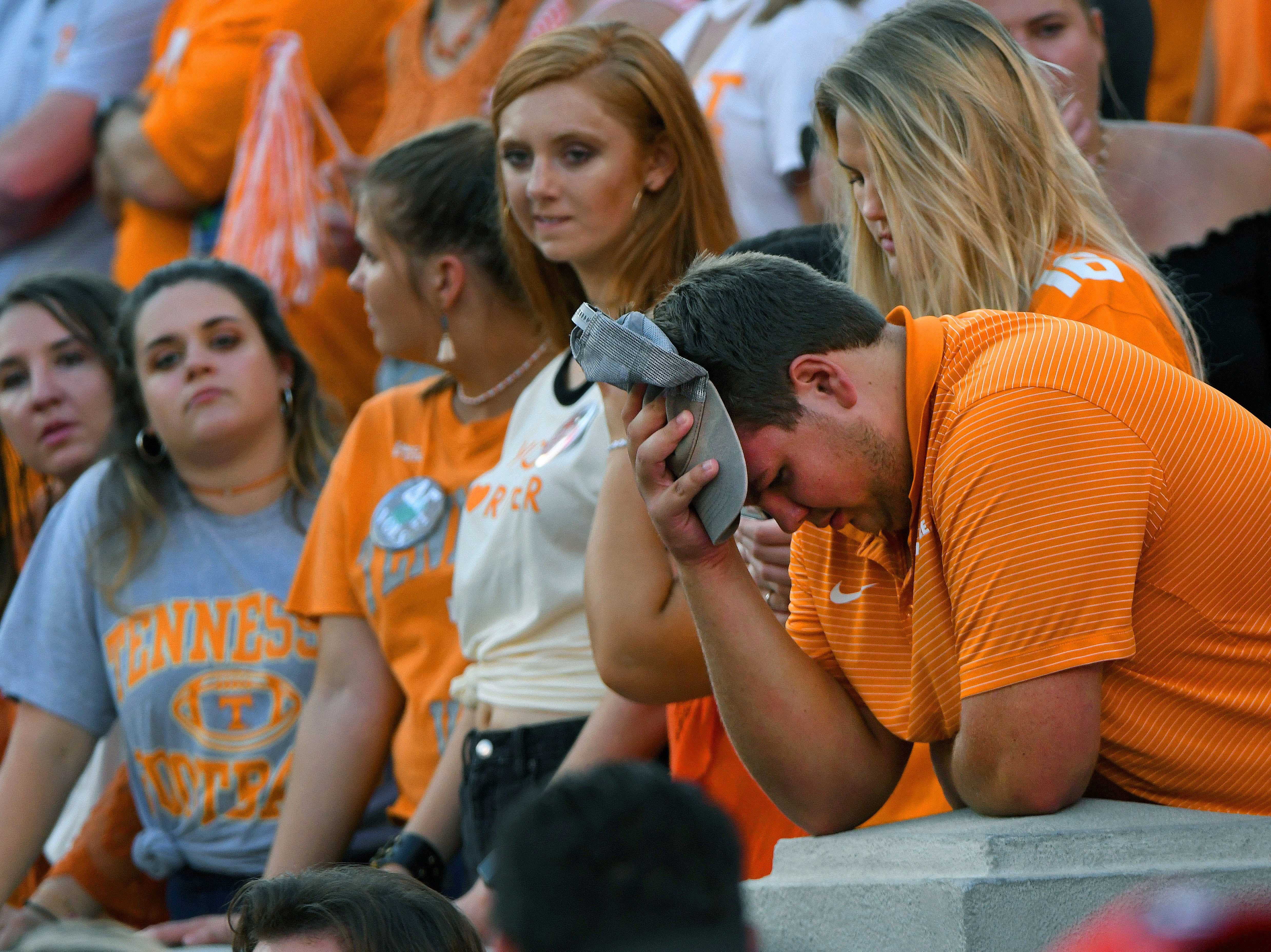 Charlie Collier, from Franklin, and many other Volunteer fans show their disappointment during second half action of their 38-12 loss to Georgia Saturday, September 29, 2018 at Sanford Stadium in Athens, GA.