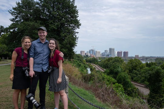 Andrew Capps (center) poses with fellow News21 student reporters Tilly Marlatt (left) of DePauw University and Lillianna Byington of George Washington University while reporting in Richmond, Virginia.