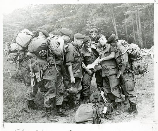 U.S. Army Special Forces confer in Cades Cove before joining the search for Dennis Martin, 6, on June 18, 1969, in the Great Smoky Mountains National Park.