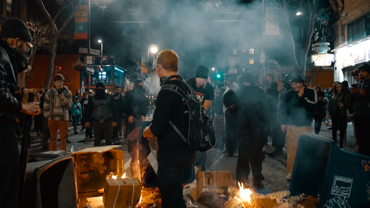 """A still from Nick Stumphauzer's documentary """"How to Kill 14 People without Saying a Word"""" shows riots that occurred on Feb. 1, 2017 in Berkeley, Calif., captured by Dapree Doyle of the Daily Californian. Stumphauzer was there to attend a speech by controversial conservative and pro-Trump commentator Milo Yiannopoulos, which was cancelled."""