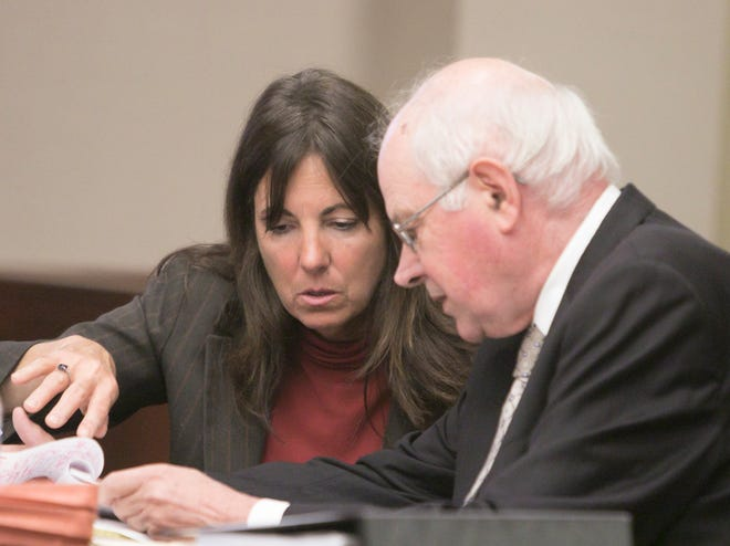 Judge Theresa Brennan and her attorney Dennis Kolenda talk over details of the Judicial Tenure Commission hearing Tuesday, Oct. 2, 2018.