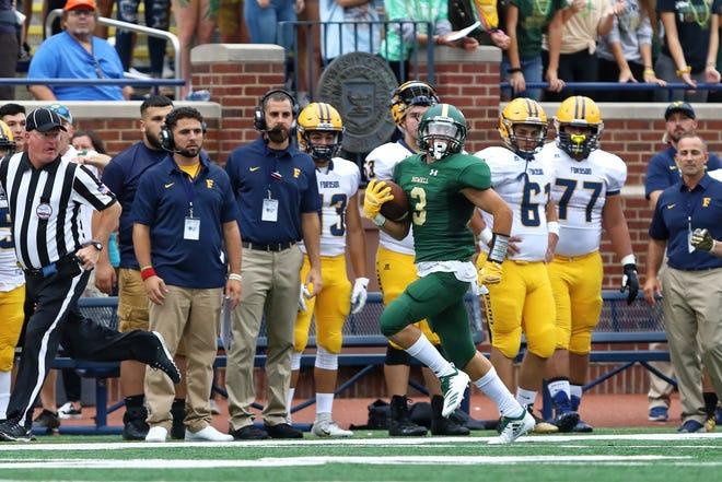 Howell's Shane Sovik has a 94-yard run against Dearborn Fordson at Michigan Stadium on Saturday, Aug. 25, 2018.