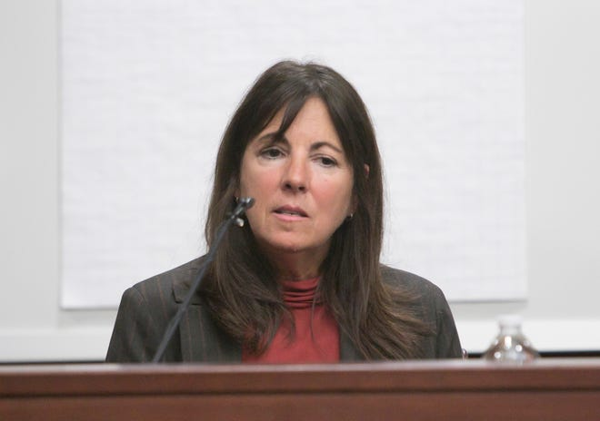 District Court Judge Theresa Brennan considers her response to a question from Commission executive director Lynn Helland in a Judicial Tenure Commission hearing Tuesday, Oct. 2, 2018.