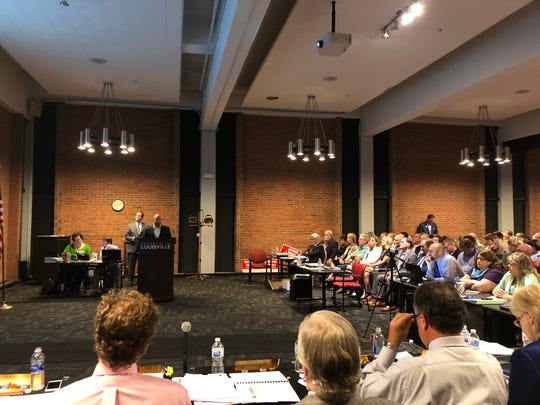 Tanner Micheli, Topgolf's director of real estate development, addresses the Louisville Planning Commission before a packed house at the University of Louisville Shelbyhurst Campus.