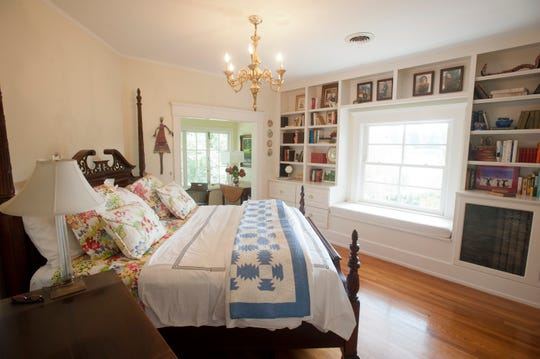 Lynne Phillips' master bedroom includes a wall of built-in bookcases.September 19, 2018