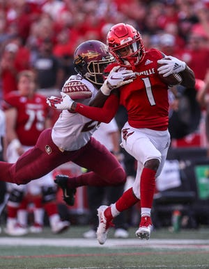 Louisville's TuTu Atwell ran for 53 yards after this catch against Florida State. Sept. 29, 2018
