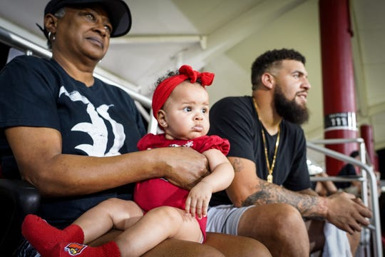 Karen Carbin (left), James Hearns (right) and Kennadi Carbin's daughter Kali watch as Kennadi plays during a Louisville soccer game. Sept 20, 2018.