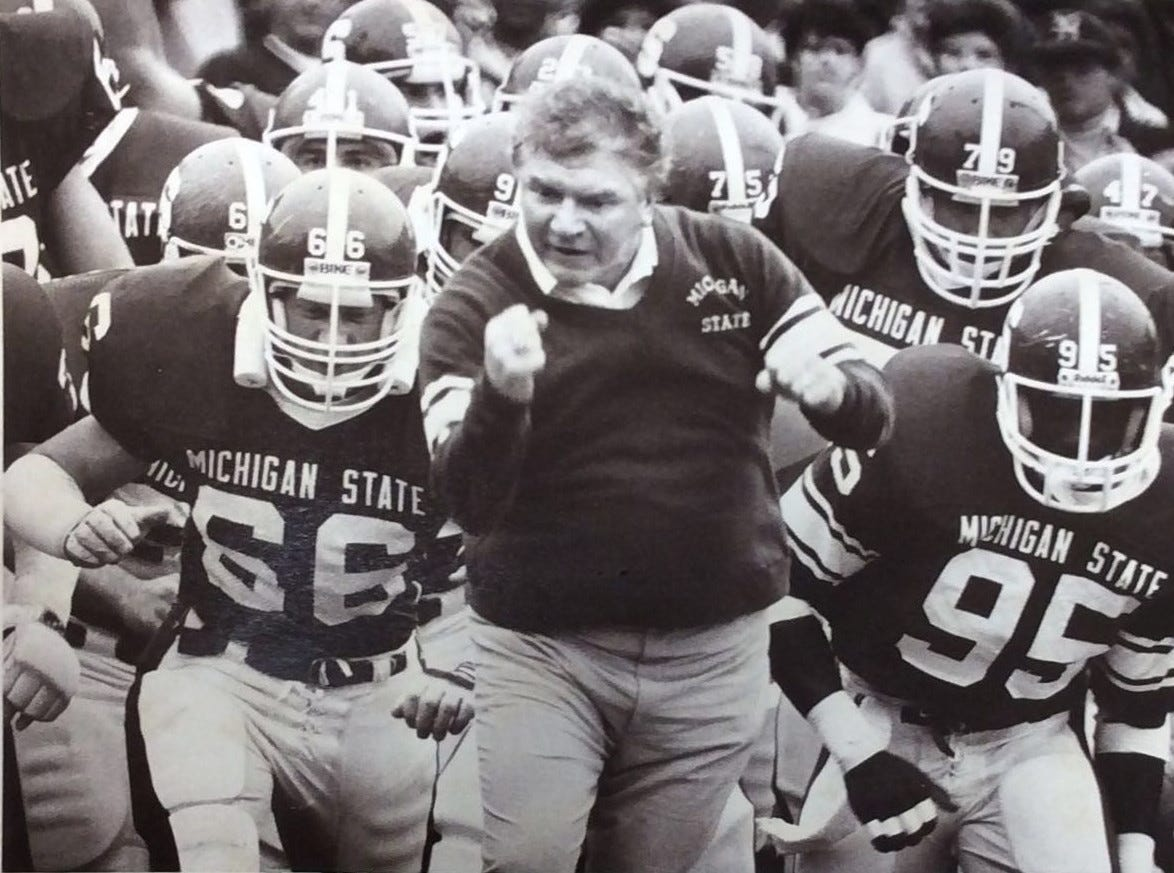 A feisty George Perles sends his troops onto the battlefield at the start of the war against U-M, 1985.
