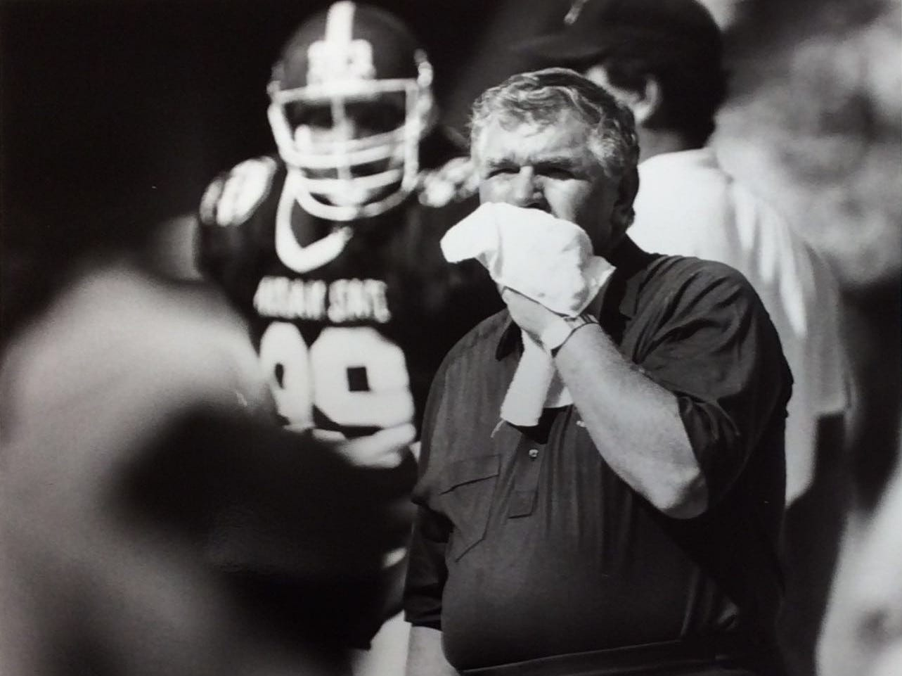 George Perles wipes his face during the fourth quarter of the Aloha Bowl, 1989.