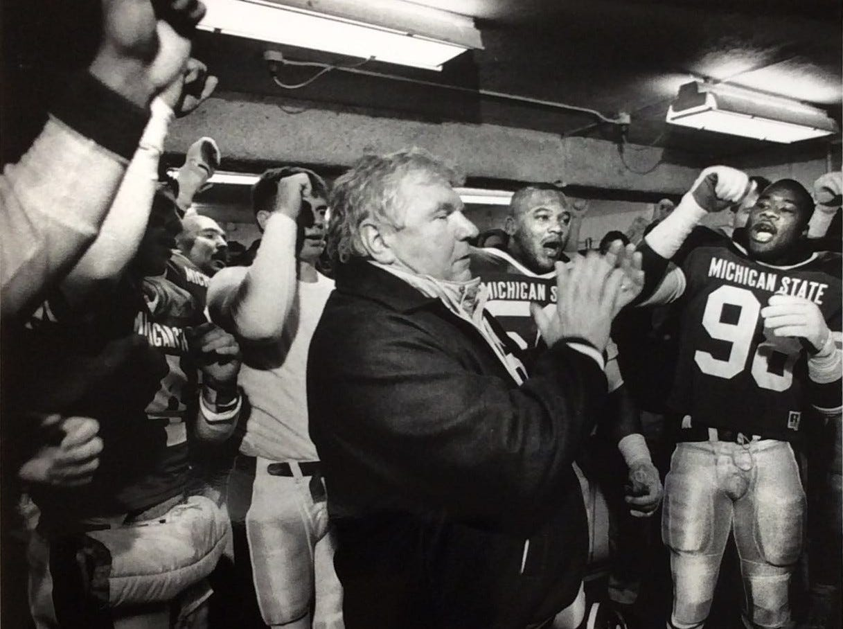 MSU football coach George Perles leads the cheers after the Spartans defeated Big Ten rival Wisconsin 14-9. MSU officially accepted a bowl invitation to the John Hancock Bowl against Southern Cal on Jan. 1 in El Paso, Texas.