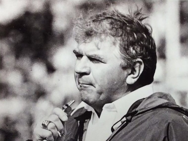 MSU Football Coach George Perles looks on during pre-game drills, November 1986.
