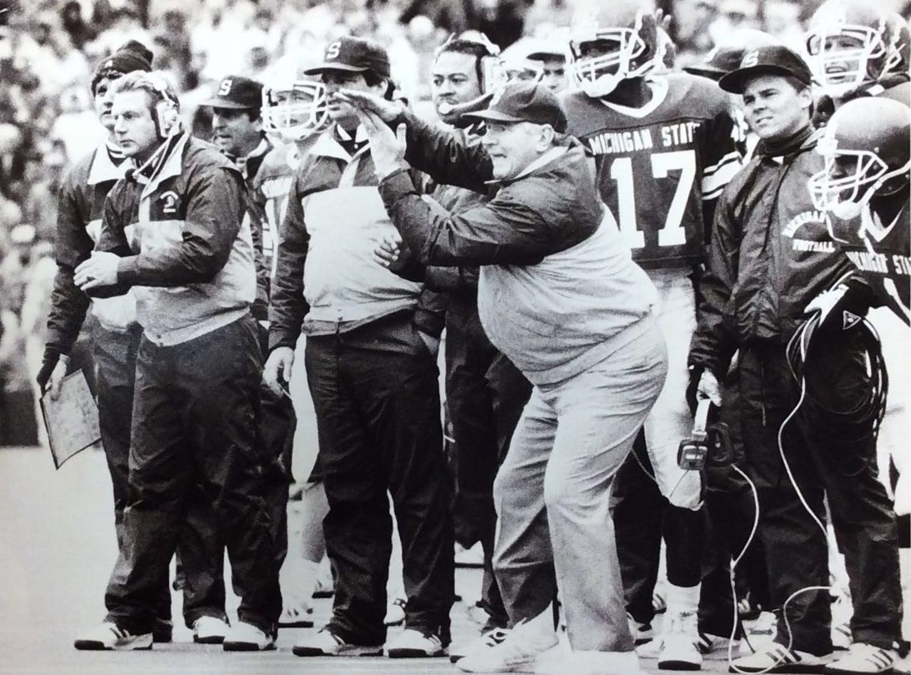 MSU Football Coach George Perles calls a frantic time out in the last seconds of the MSU/Illinois game to attempt a winning field goal that was blocked, Jan. 27, 1988.