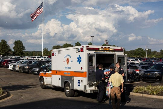 October 02 2018 - A person is put into an ambulance after being overwhelmed by the temperature before the start of the Trump Rally in Southaven on Tuesday.
