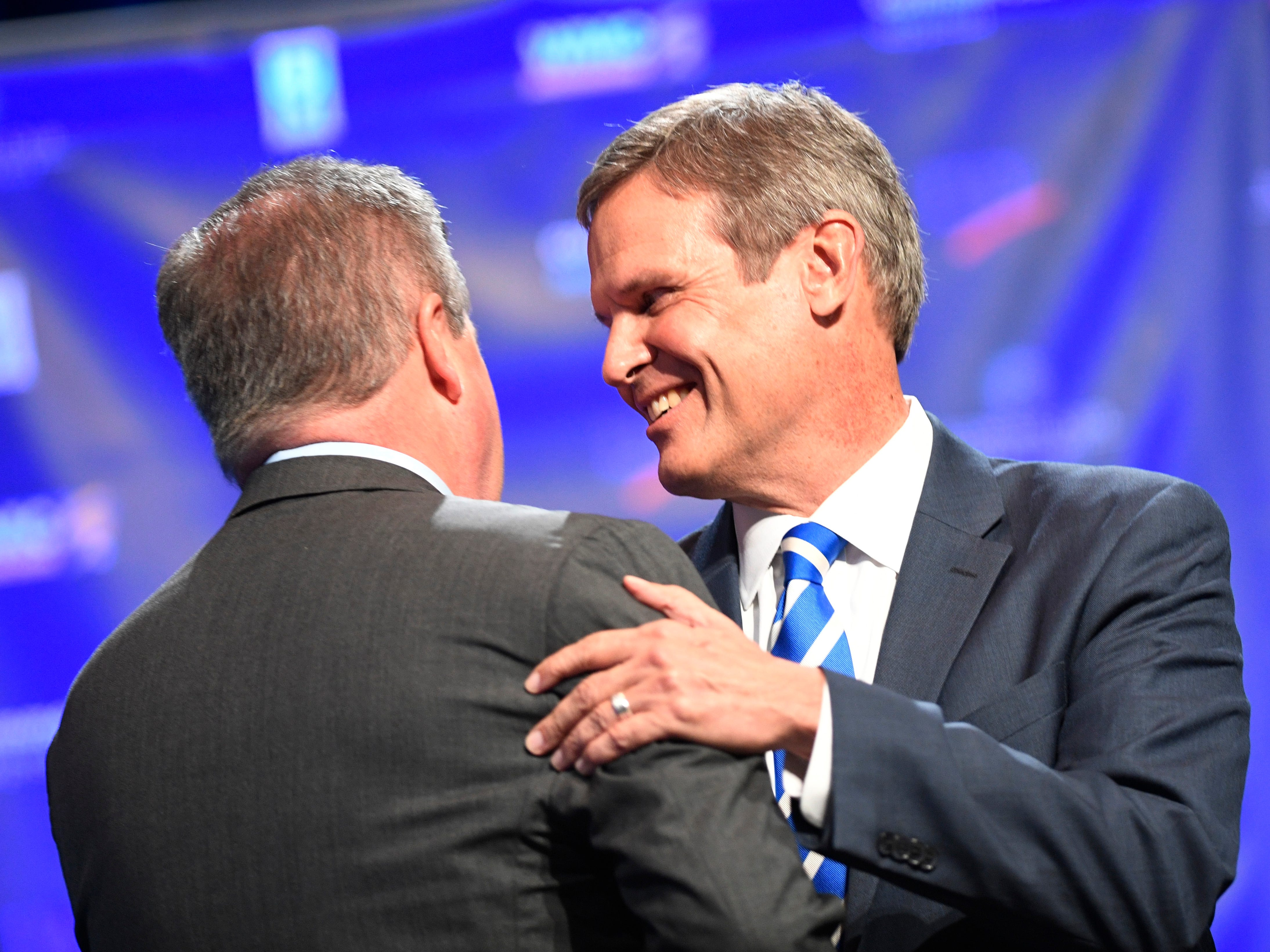 Tennessee gubernatorial candidates Democrat Karl Dean, left, and Republican Bill Lee greet each other at the start of the debate at the University of Memphis' Michael D. Rose Theater in Memphis, Tenn., on Tuesday, Oct. 2, 2018.