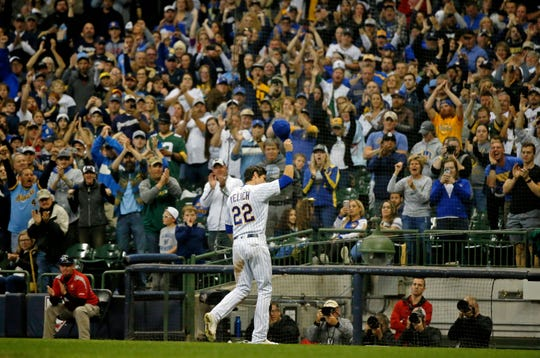MILWAUKEE, WI - SEPTEMBER 30: Christian Yelich #22 of the Milwaukee Brewers acknowledges the crowd as he receives a standing ovation as he is taken out of the game against the Detroit Tigers during the eighth inning at Miller Park on September 30, 2018 in Milwaukee, Wisconsin.  (Photo by Jon Durr/Getty Images)