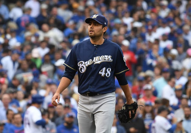 Brewers reliever Joakim Soria walks off the field after striking out Javier Baez with runners on first and second to end the Cubs' half of the sixth inning on Monday.