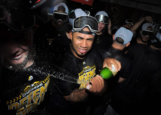 Junior Guerra sprays some champagne in a teammate's face as the Brewers celebrate winning the NL Central Division title last October.