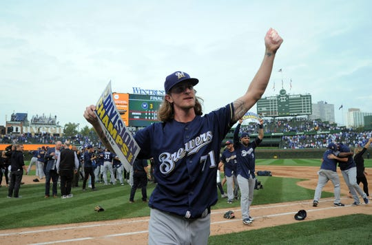 A triumphant Josh Hader walks off the field after the Brewers beat the Cubs on Oct. 1 in Chicago to claim the NL Central Division title.