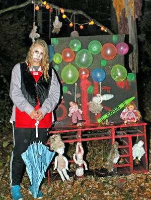 Kettle Moraine High School student Makayla Mustas waits for visitors on the Fright Hike in Lapham Peak State Park.