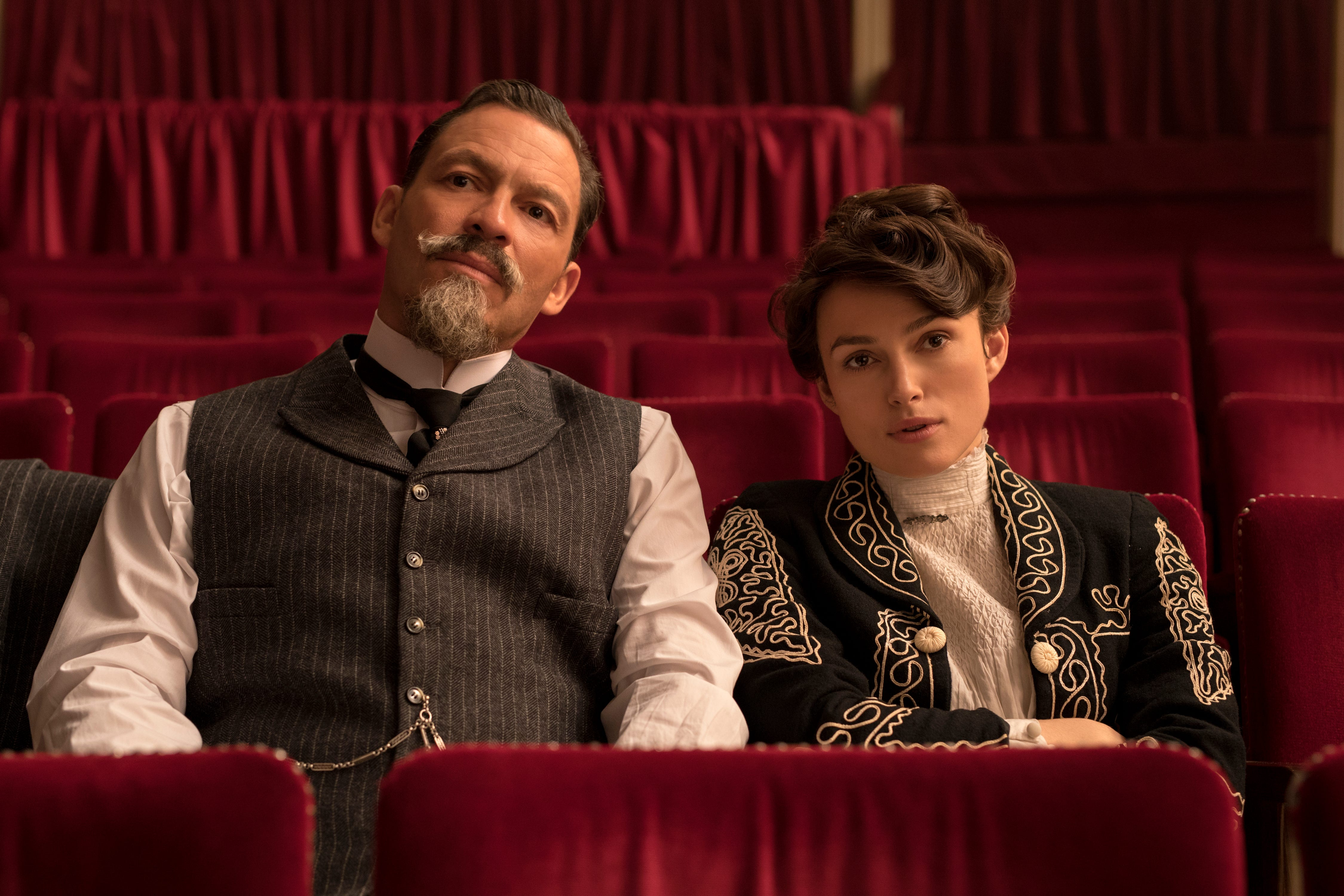 """Colette (Keira Knightley, right) seeks to find her own voice while writing under her husband's (Dominic West) name in """"Colette."""""""
