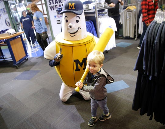 Two-year-old Austin Temke poses for a photo with the Brewers' Barrelman mascot. His mother, Laura Temke of Wauwatosa, was among the people shopping at the pro shop at Miller Park.