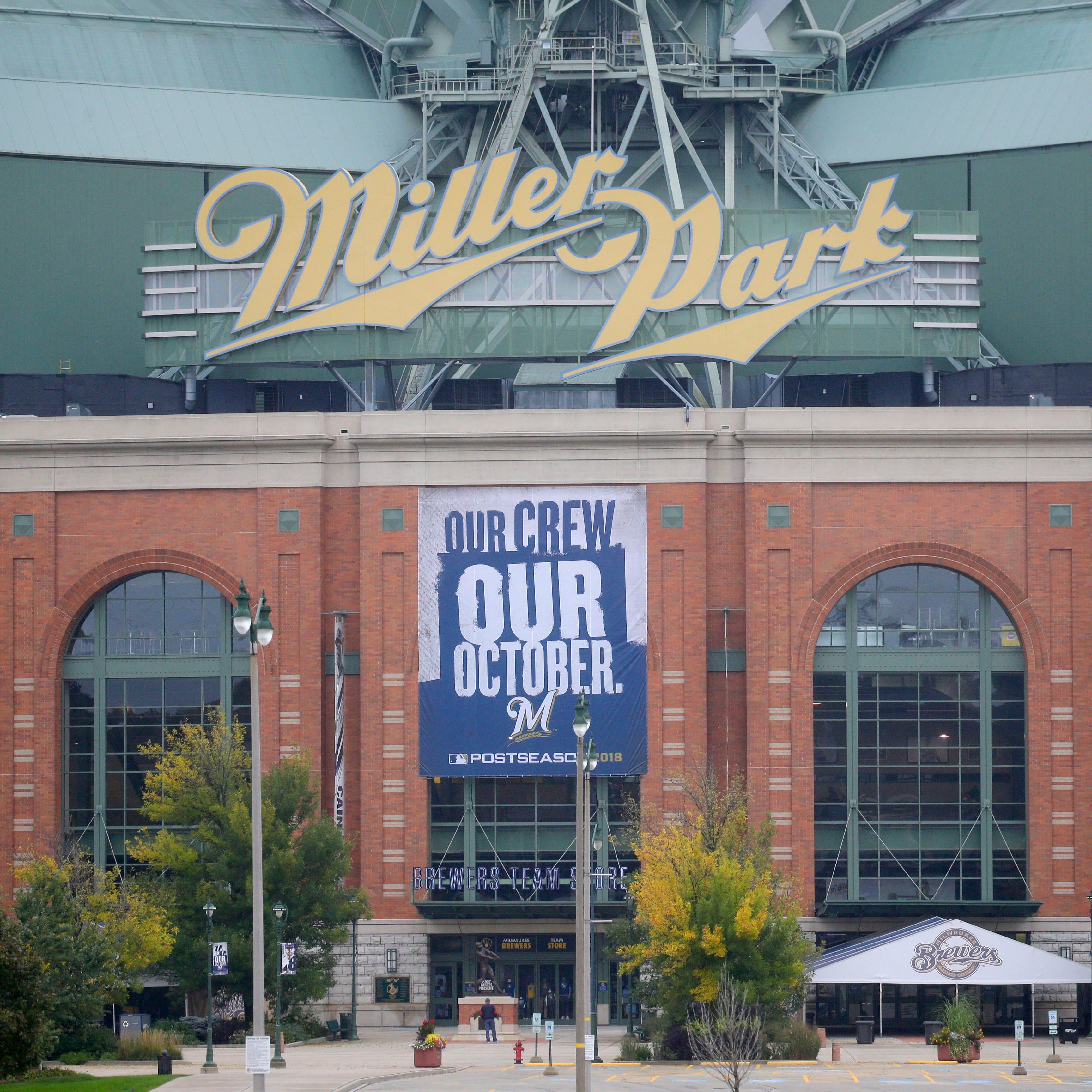 A postseason banner hangs outside Miller Park.