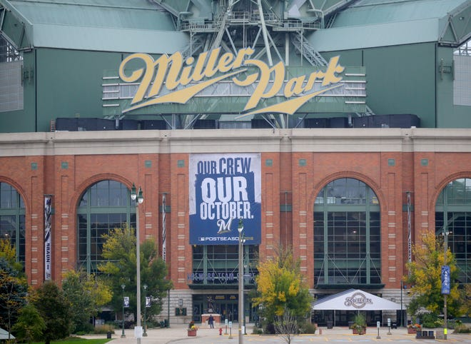 A postseason banner hangs outside Miller Park.