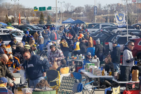 Brewers fans tailgate outside Miller Park  in April for a game against the Cardinals. The scene in the parking lots outside Miller Park is pretty much the same for every Brewers home game.