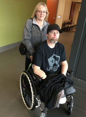 Greg Manteufel of West Bend, Wisconsin, and his wife, Dawn, on Oct. 2, 2018, at Froedtert Hospital in Milwaukee where Greg Manteufel spent three months battling a life-threatening infection that cost him all four of his limbs.