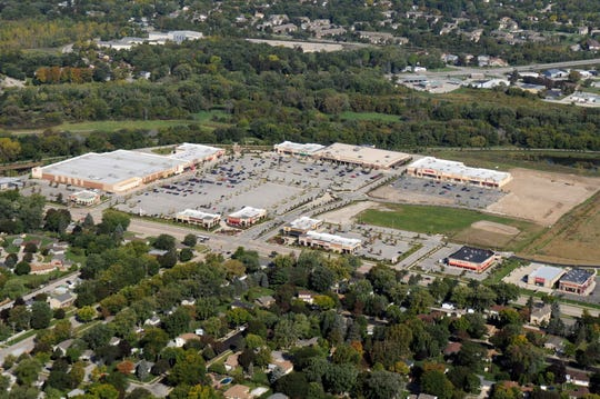 The Shoppes at Fox River, shown in this 2013 aerial view, has expanded considerably since construction began in 2008. This photo predates the addition of Hobby Lobby to the east, a new section of buildings near its mid-section, and the 2016  third-phase expansion that now includes Old Navy and Skechers in 2018.