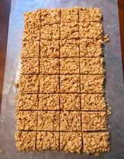 Julie Bussen's Peanut Butterscotch Bites are cut into squares after cooling.