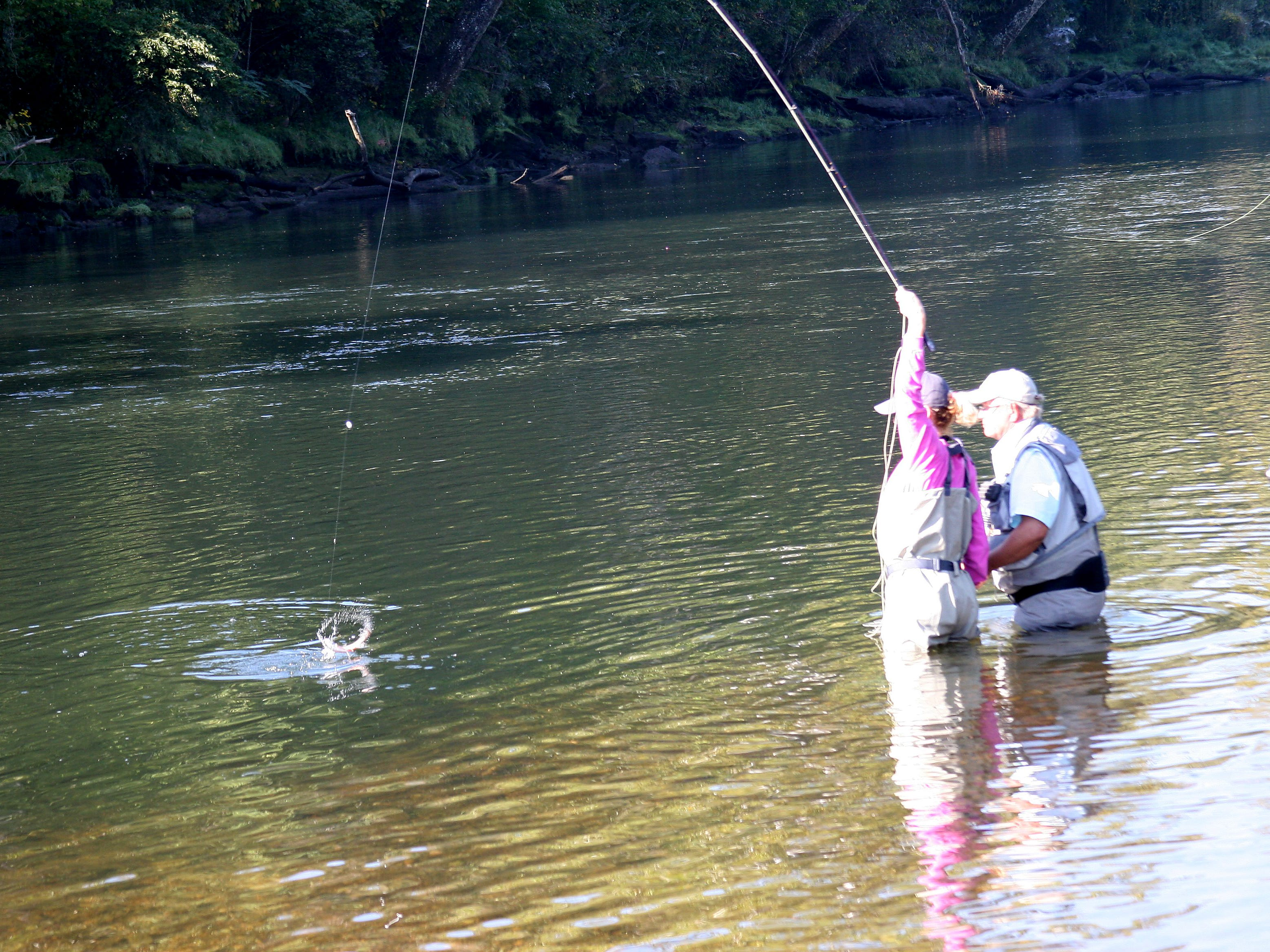 And within minutes of her first few casts, Jackie Bolt of Bentonville caught her first trout with the help of volunteer guide Kevin Brandtonies of Gassville.