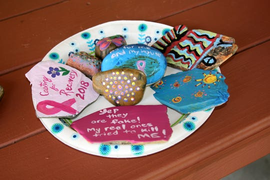 Participants of the Casting for Recovery event took river rocks and painted them as part of the weekend activities.