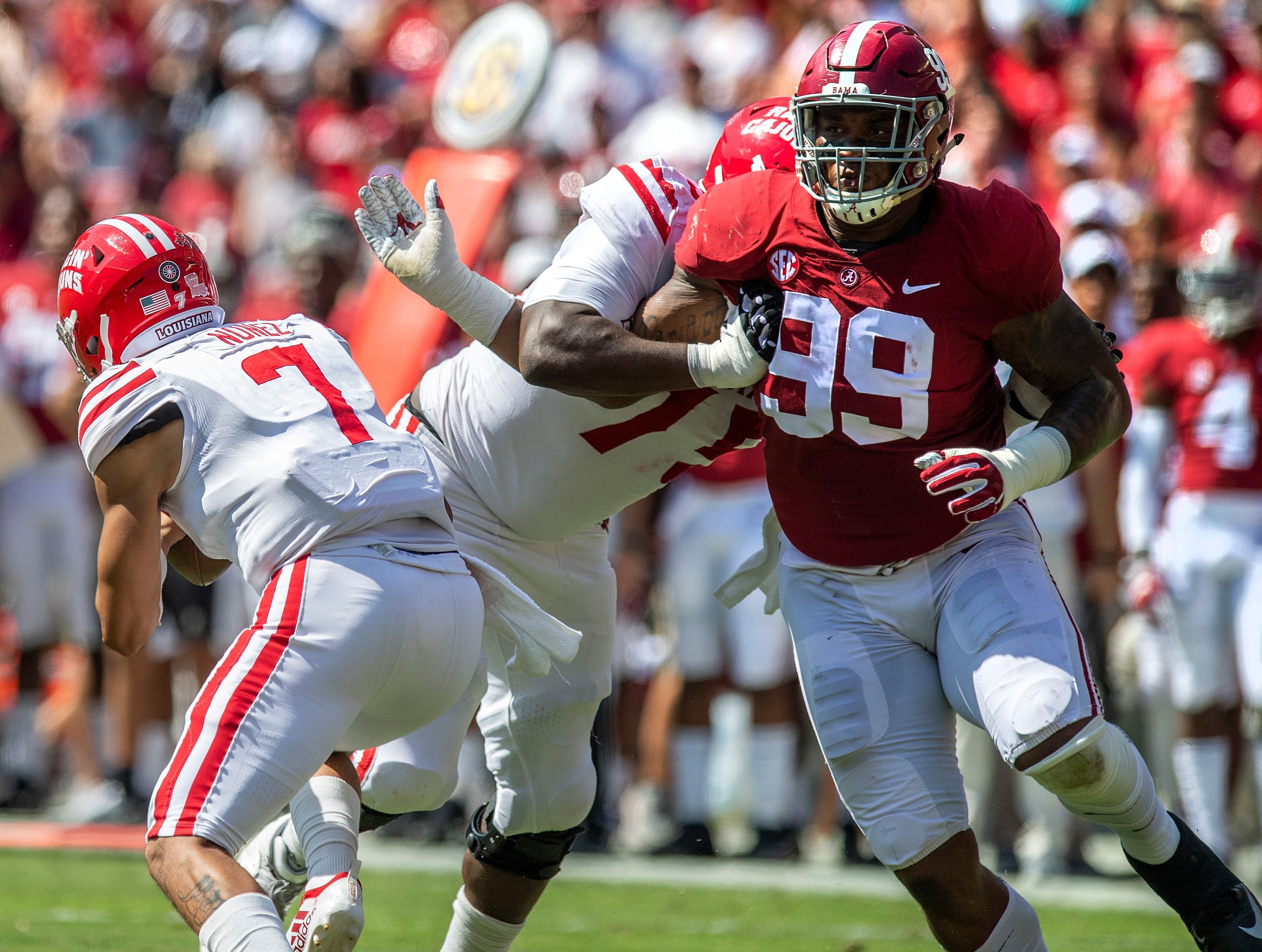 Alabama defensive lineman Raekwon Davis (99) pursues Louisiana quarterback Andre Nunez (7) In first half action at Bryant-Denny Stadium in Tuscaloosa, Ala., on Saturday September 29, 2018.