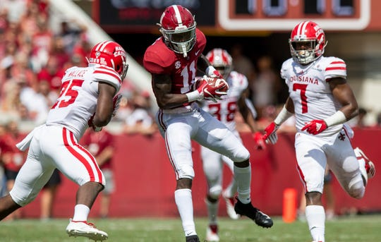 UL's Ferrod Gardner (7) runs behind receiver Henry Ruggs III during the Cajuns' loss at No. 1 Alabama earlier this year.