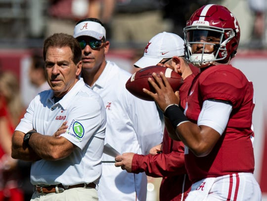 Alabama head coach Nick Saban and quarterbacks coach Dan Enos  look on as Alabama quarterback Jalen Hurts (2) warms up before the Alabama vs. Louisiana game in Tuscaloosa, Ala., on Saturday September 29, 2018.