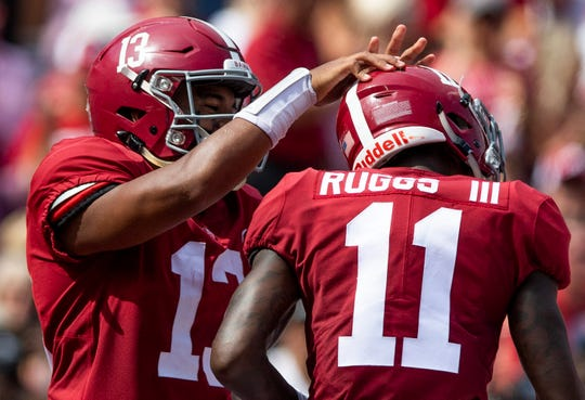 Alabama quarterback Tua Tagovailoa (13) and quarterback Jalen Hurts (2) celebrate Ruggs' touchdown against Louisiana in first half action at Bryant-Denny Stadium in Tuscaloosa, Ala., on Saturday September 29, 2018.