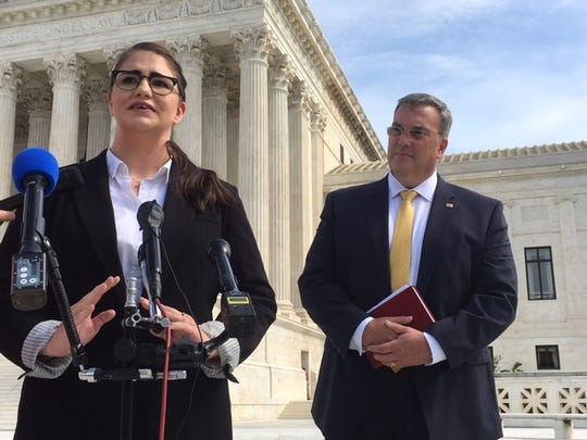 Hannah Martinez, granddaughter of Mobile police officer Julius Schulte, who was killed in 1985, thanked Alabama officials Oct. 2, 2018 for following through on the execution case of Vernon Madison at the U.S. Supreme Court. William Johnson, executive director of the National Association of Police Organizations, (right) filed a brief in the case siding with Alabama.