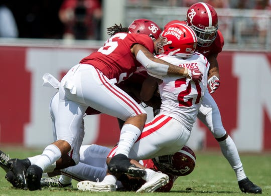 Alabama linebacker Markail Benton (36) and defensive back Josh Jobe (28) tackle Louisiana wide receiver Keenan Barnes (21)  at Bryant-Denny Stadium in Tuscaloosa, Ala., on Saturday September 29, 2018.