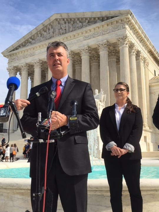 Alabama Attorney General Steve Marshall spoke to reporters Oct. 2, 2018 after hearing arguments at the U.S. Supreme Court. Hannah Martinez, the granddaughter of Julius Schulte, the Mobile police officer who was shot in 1985, stands next to Marshall.