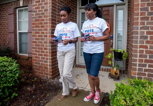 Rhonda Oats, candidate for School Board District 5, is shown campaigning with her daughter MaChea Jones, left, in Montgomery, Ala., on Thursday September 27, 2018.