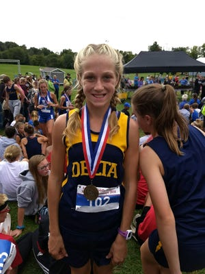 Delta Middle School's Nicki Southerland after winning the state meet.